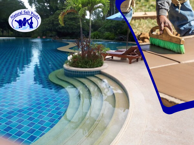 big-inground-swimming-pool-surrounded-with-plants-wooden-brown-pool-chair-and-pool-expert-working-on-pool-coping-repair