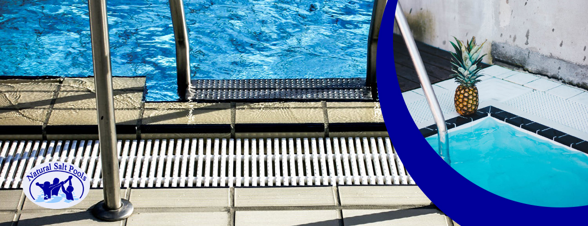Inground-swimming-pool-stairs-pool-tiles-and-pool-skimmer-with-a-small-picture-of-a-pineapple-on-top-of-pool-skimmer