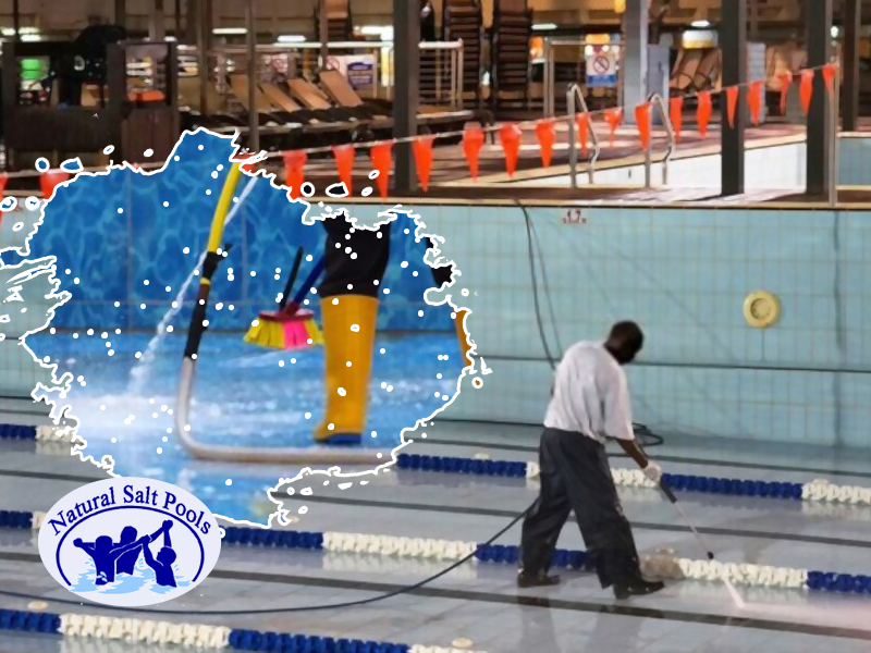 swimming-pool-expert-using-pool-pressure-washer-for-pool-floor-cleaning-in-inground-pool